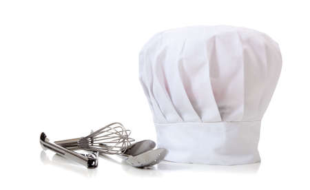 toque: A chefs hat and utensils on a white background Stock Photo