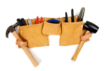 A brown leather toolbelt with assorted tools including a hammer, screwdrivers, pliers, tape measure etc.   Stockfoto