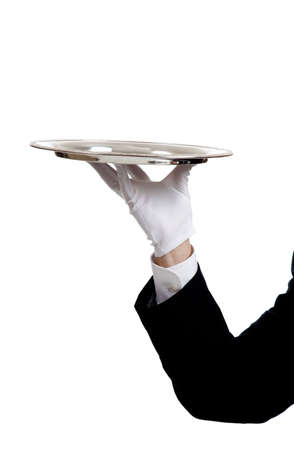 A waiters arem with a glove on the hand hoding a silver serving tray with copy space Stock Photo - 5472290