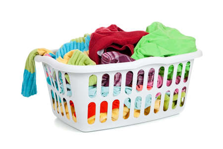 A white basket full of dirty laundry on a white background  Imagens