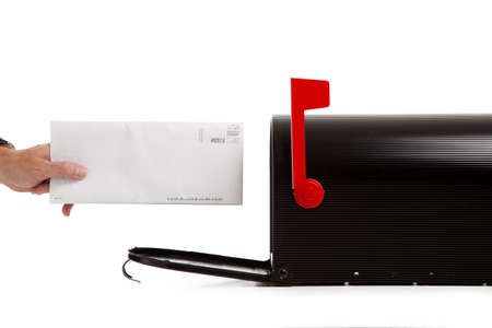 A person or maillman either sending or receiving mail in a black mail box on white background Stock Photo - 5472295