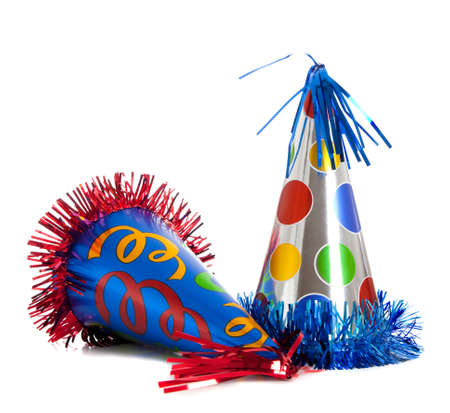 conical hat: Group of colorful birthday party hats on white background with copy space