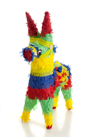 A traditional, primary colored Mexican party pinata on a white background photo