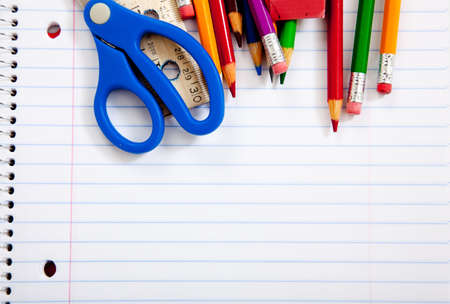 school desk: Assorted school supplie with a notebooks, pencils, pens, scissors etc.