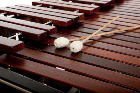 A marimba on white with mallets and copy space Imagens