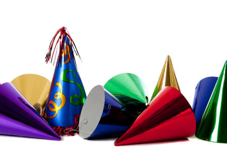 Group of colorful birthday party hats on white background with copy space photo