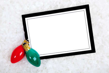 notecard: A blank white note card or invitation or greeting card with copy space includedd Christmas lights