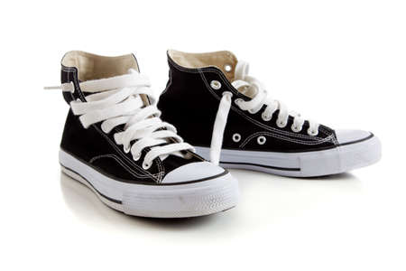 shoe string: Black canvas high top sneakers or tennis shoes on a white background