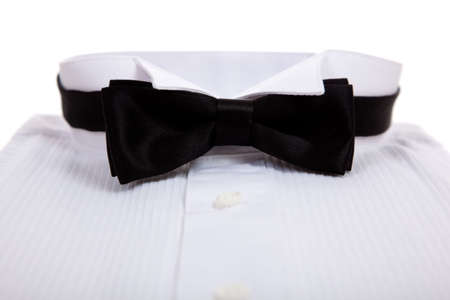 A black bow tie and a tuxedo shirt on a white background Stock Photo - 5522772