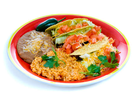A colorful Mexican food plate with tacos, bean and rice