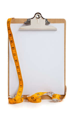 A blank clipboard with a yellow measuring tape with copy space on white background photo