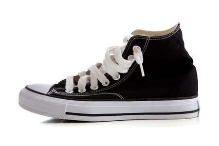 tennis shoe: Black canvas high top sneakers or tennis shoes on a white background