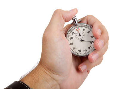 A caucasian male hand holing a stop watch on a white background