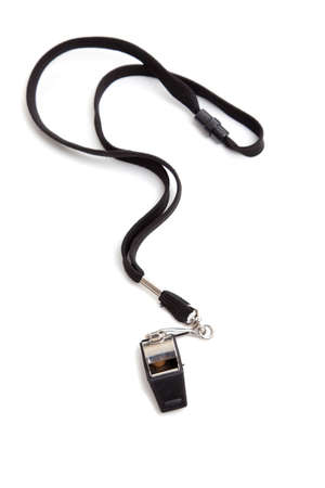 whistle: A coaches whistle with lanyard on a white background with copy space