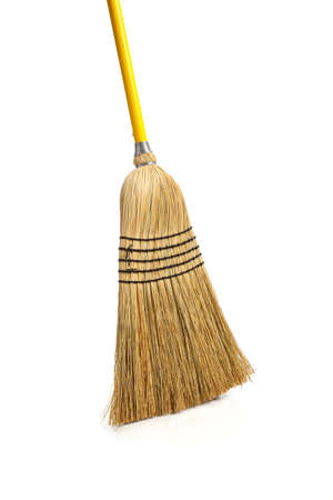household objects equipment: A new corn broom on a white background, sweeping- Household chores concept