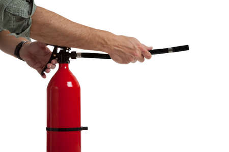 A mans hands and arms acitivating a fire extinguisher - avoiding an emergency Imagens