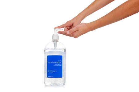 dispensing: A childs hand dispensing hand sanitizer - swine flu prevention theme - on a white background with copy space Stock Photo
