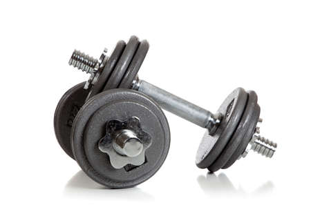 kilos: A set of weightlifting dumbbells on a white background with copy space