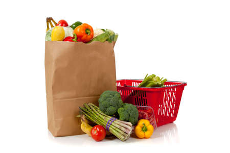 grouping: A grouping of fresh produce including fruits and vegetables in a grocery bag or sack with copy space Stock Photo