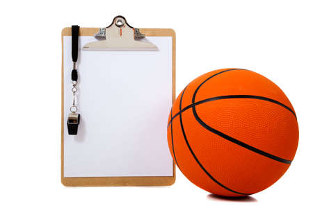 A basketball coachs clipboard with basketball and whistle on white background with copy space