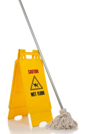 A wet floor sign and mop on a white background photo