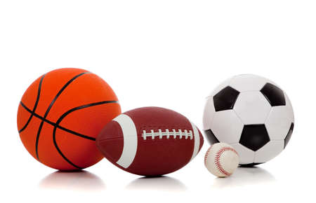 basketball ball: An assortment of sports balls including basketball, american football, soccerball and baseball on a white background