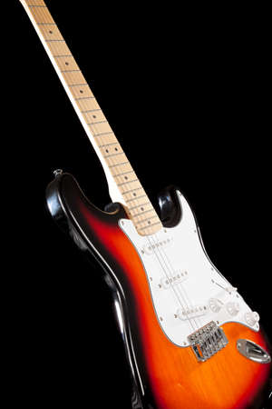 An Electric guitar on black background photo