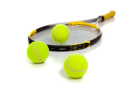 tennis racket: A yellow tennis raquet with yellow tennis balls on a white background