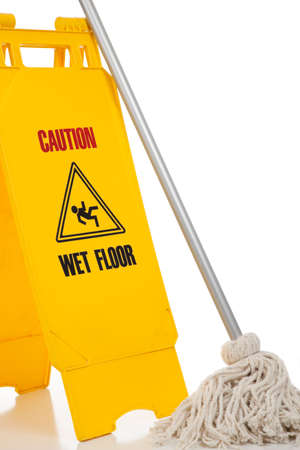 A wet floor sign and mop on a white background Stock Photo - 5635714