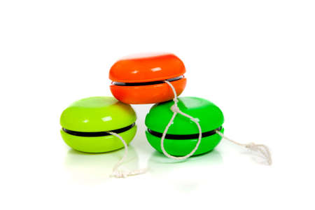 play yoyo: Green and red yoyos on a white background with copy space