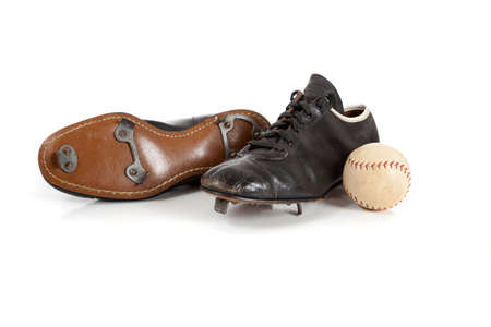cleats: A pair of baseball cleats on a white background