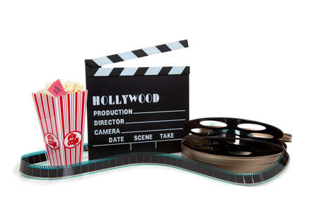 movie theatre: A movie reel with clapboard and popcorn on a white background Stock Photo