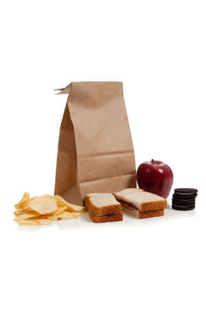apple sack: A sack lunch with peanut butter sandwich and a apple Stock Photo