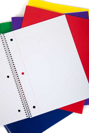 college ruled: multi colored folders with  a blank notebook on a white background Stock Photo