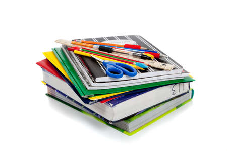 fournitures scolaires: Several spiral notebooks with school supplies on top
