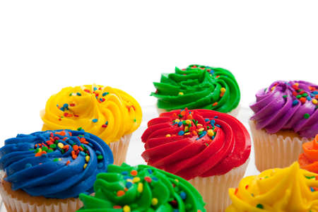 Multi colored cupcakes on white background photo