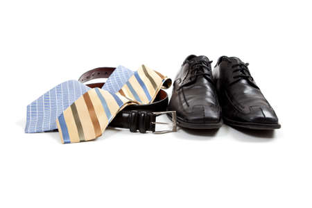 mens clothing: assorted mens clothing accessories including shoes, ties, belt Stock Photo