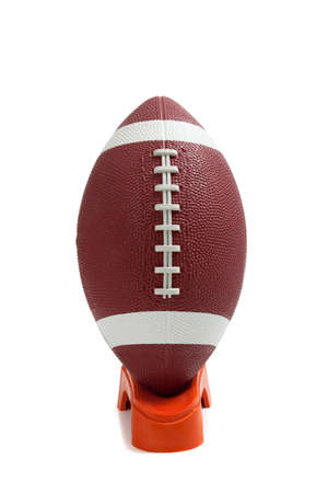 punt: An american football on a kicking tee