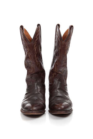 footware: Brown leather cowboy boots on a white background Stock Photo