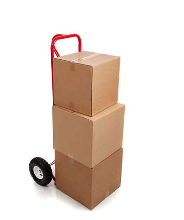 handtruck: Brown cardboard moving box on a white background with a fragile sticker