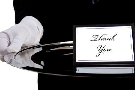 silver tray: White gloved hand holding a silver tray with a thank you card