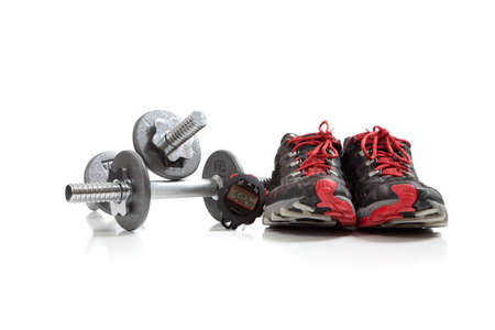 rigorous: Dumbbells and tennis shoes on a white background Stock Photo