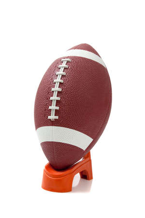 An american football on a kicking tee