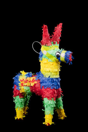 mexican pinata on a black background photo