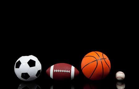 Multi sports balls on a black background 스톡 콘텐츠