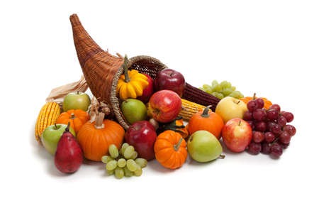 indian thanksgiving: A Fall arrangement in a cornucopia on a white background Stock Photo