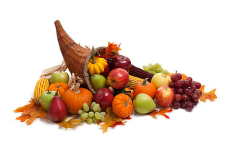 thanksgiving cornucopia: A Fall arrangement in a cornucopia on a white background Stock Photo