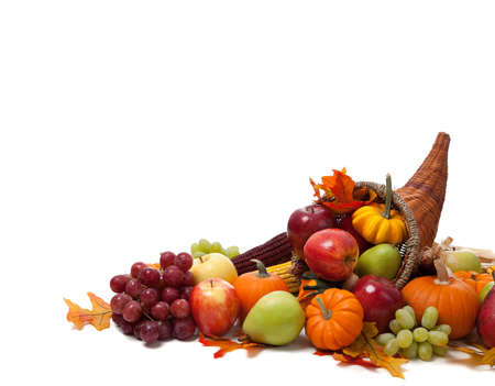 thanksgiving harvest: A Fall arrangement in a cornucopia on a white background Stock Photo