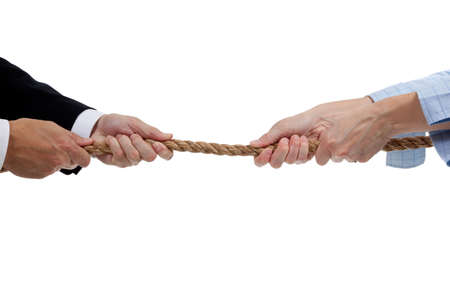 Man and a woman pulling a rope on a white background photo