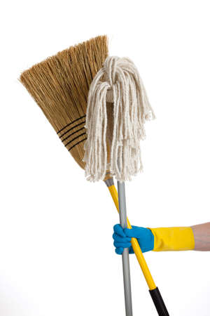 A mop and a brrom being held by a rubber gloved hand Stock Photo - 5700796